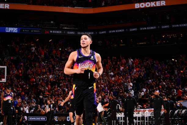 Devin Booker of the Phoenix Suns smiles during the game against the LA Clippers during Game 1 of the Western Conference Finals of the 2021 NBA...