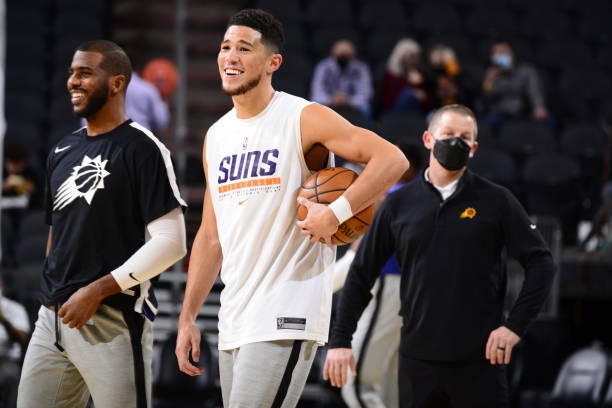 Devin Booker of the Phoenix Suns smiles prior to a game against the Golden State Warriors on March 4, 2021 at Talking Stick Resort Arena in Phoenix,...
