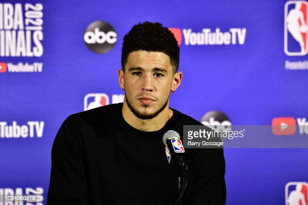 Devin Booker of the Phoenix Suns speaks with the media after falling to the Milwaukee Bucks during Game Six of the 2021 NBA Finals on July 20, 2021...