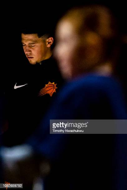 Devin Booker of the Phoenix Suns stands during a moment of silence before taking on the Denver Nuggets at Pepsi Center on October 20 2018 in Denver...
