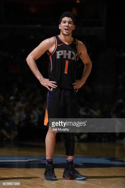 Devin Booker of the Phoenix Suns stands on the court against the Memphis Grizzlies on February 28 2018 at FedExForum in Memphis Tennessee NOTE TO...