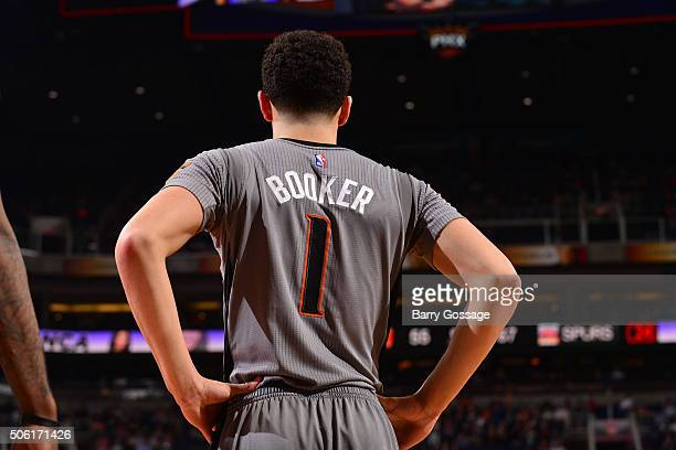 Devin Booker of the Phoenix Suns stands on the court during the game against the San Antonio Spurs on January 21 2016 at Talking Stick Resort Arena...