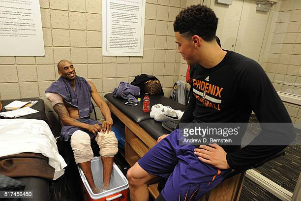 Devin Booker of the Phoenix Suns talks to Kobe Bryant of the Los Angeles Lakers after the game in the locker room on March 23 2016 at Talking Stick...