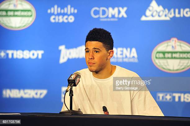 Devin Booker of the Phoenix Suns talks to the media during a press conference after the game against the San Antonio Spurs as part of NBA Global...