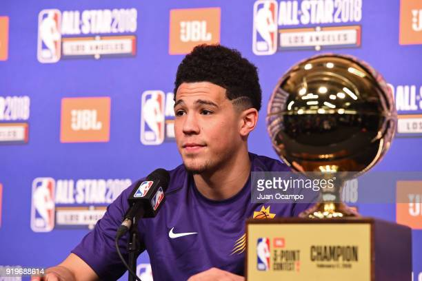 Devin Booker of the Phoenix Suns talks to the media during a press conference after winning the three point contest during State Farm AllStar...