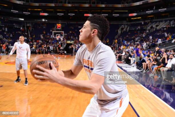 Devin Booker of the Phoenix Suns warms up before the game against the Golden State Warriors on April 5 2017 at Talking Stick Resort Arena in Phoenix...