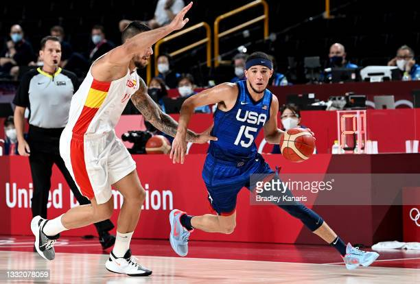 Devin Booker of the USA breaks away from the defence during the quarter final Basketball match between the USA and Spain on day eleven of the Tokyo...