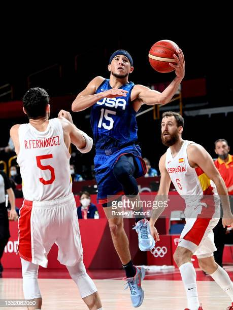 Devin Booker of the USA drives through the defence during the quarter final Basketball match between the USA and Spain on day eleven of the Tokyo...
