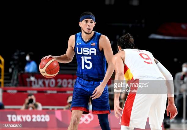 Devin Booker of the USA looks to pass during the quarter final Basketball match between the USA and Spain on day eleven of the Tokyo 2020 Olympic...