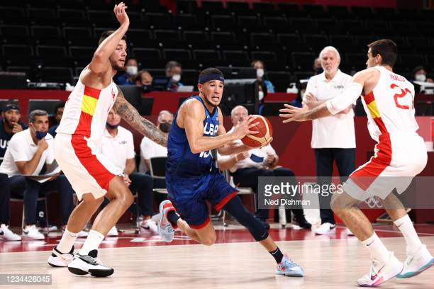 Devin Booker of the USA Men's National Team dribbles the ball during the game against the Spain Men's National Team during the 2020 Tokyo Olympics on...