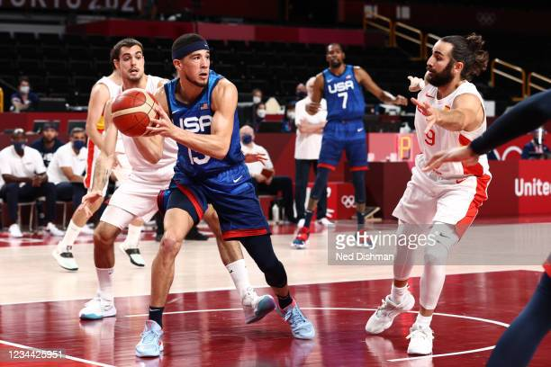 Devin Booker of the USA Men's National Team handles the ball during the game against the Spain Men's National Team during the 2020 Tokyo Olympics on...