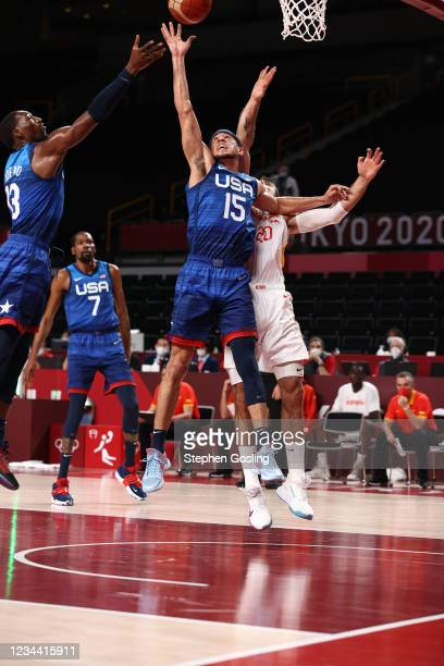 Devin Booker of the USA Men's National Team rebounds against Team Spain in the mens quarterfinal round at the Super Saitama Arena on August 3, 2021...