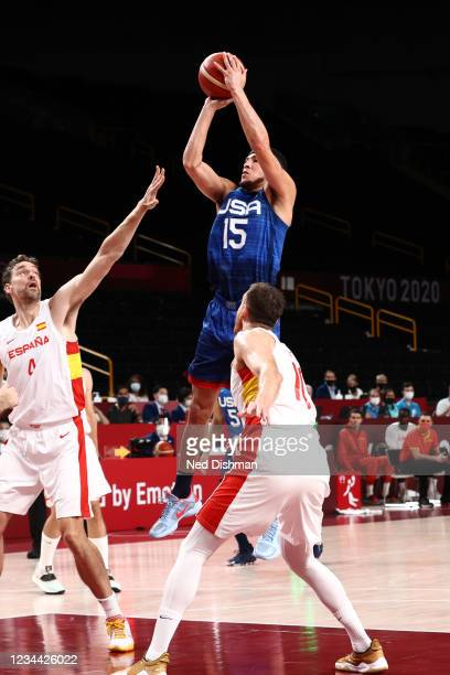 Devin Booker of the USA Men's National Team shoots the ball during the game against the Spain Men's National Team during the 2020 Tokyo Olympics on...