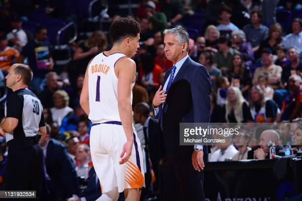 Devin Booker speaks with Head Coach Igor Kokoskov of the Phoenix Suns during the game against the Detroit Pistons on March 21, 2019 at Talking Stick...
