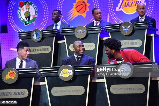 Devin Booker#1 of the Phoeix Suns Magic Johnson of the Los Angeles Lakers and Joel Embiid of the Philadelphia 76ers laugh during the 2017 NBA Draft...
