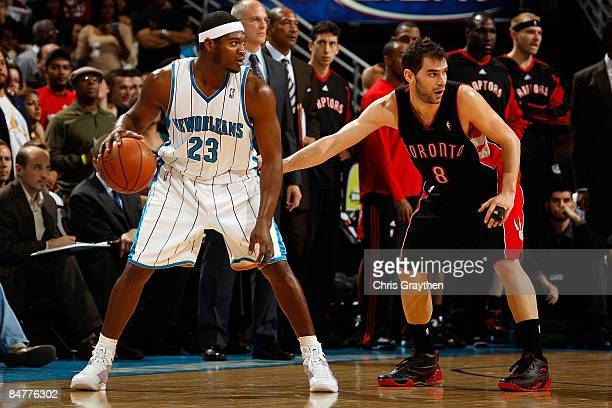 Devin Brown of the New Orleans Hornets drives the ball around Jose Calderon of the Toronto Raptors on February 6 2009 in New Orleans Louisiana NOTE...