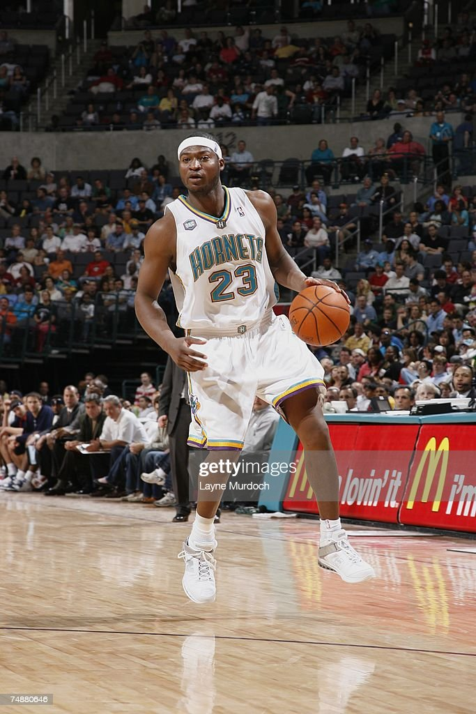 c13a44267ab Devin Brown of the New Orleans Oklahoma City Hornets moves the ball ...