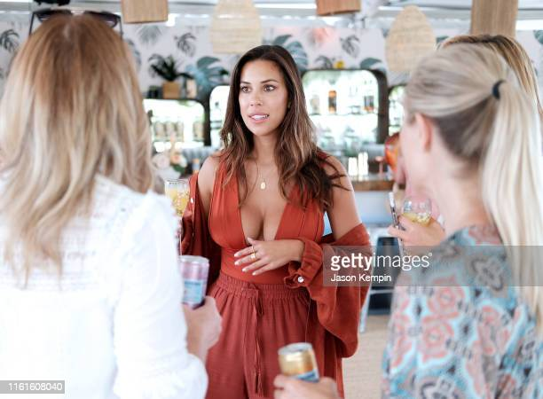 Devin Brugman with guests attend as JNSQ Serves Its Rosé Cru And Sauvignon Blanc At The Miami Swim Week Influencer Brunch Hosted By Natasha Oakley...