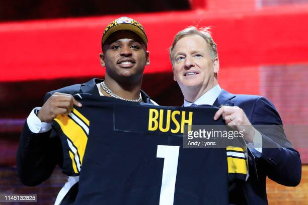 Devin Bush of Michigan poses with NFL Commissioner Roger Goodell after being chosen overall by the Pittsburgh Steelers during the first round of the...