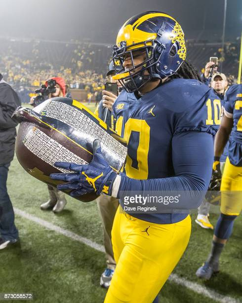 Devin Bush of the Michigan Wolverines holds the LITTLE BROWN JUG after defeating the Minnesota Golden Gophers 3310 after a college football game at...