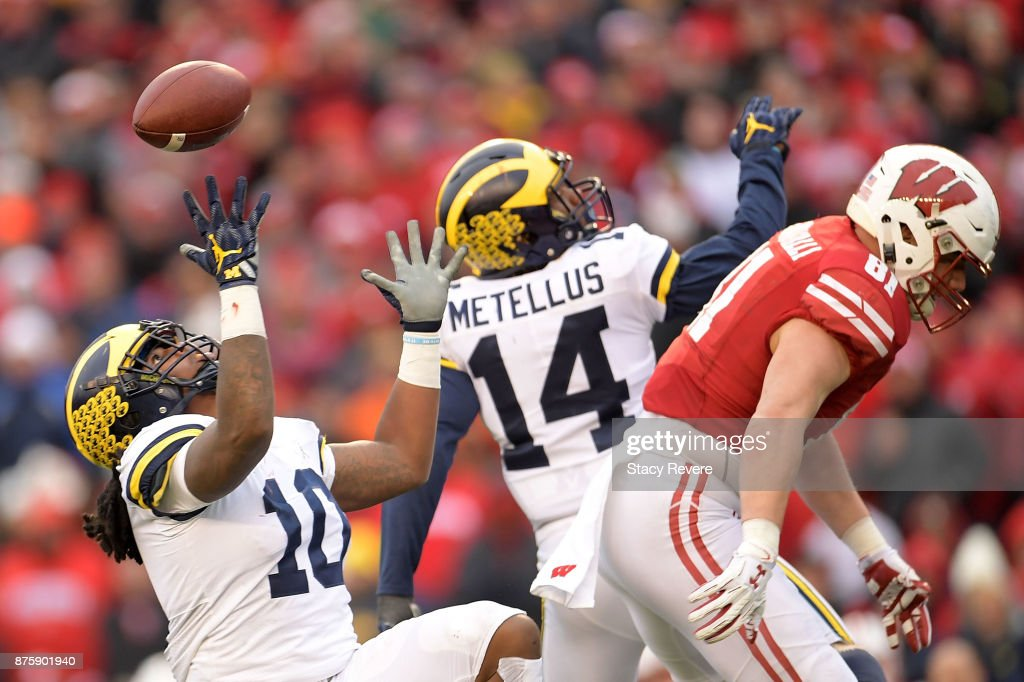 Devin Bush #10 of the Michigan Wolverines intercepts a pass during the third quarter of a game against the Wisconsin Badgers at Camp Randall Stadium on November 18, 2017 in Madison, Wisconsin.