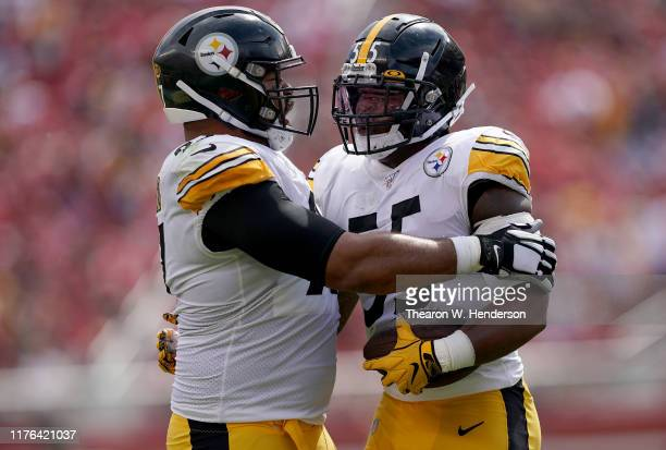 Devin Bush of the Pittsburgh Steelers is congratulated by Cameron Heyward after Bush recovered a fumble against the San Francisco 49ers during the...