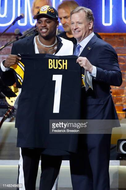 Devin Bush poses with NFL Commissioner Roger Goodell after being drafted tenth overall by the Pittsburgh Steelers on day 1 of the 2019 NFL Draft on...