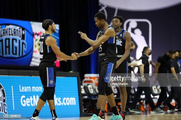 Devin Cannady and Mamadi Diakite of the Lakeland Magic shake hands during the game against the Delaware Blue Coats on February 26, 2021 at HP Field...