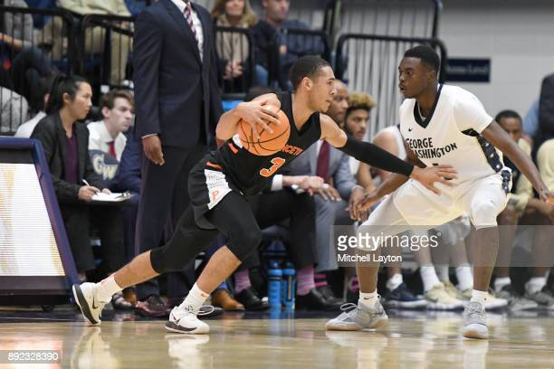 Devin Cannady of the Princeton Tigers dribbles around Terry Nolan Jr #1 of the George Washington Colonials during a college basketball game at the...