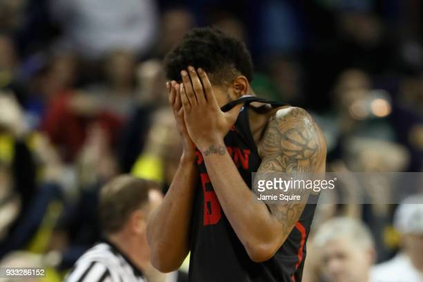 Devin Davis of the Houston Cougars reacts to their 6364 loss to the Michigan Wolverines in the second half during the second round of the 2018 NCAA...