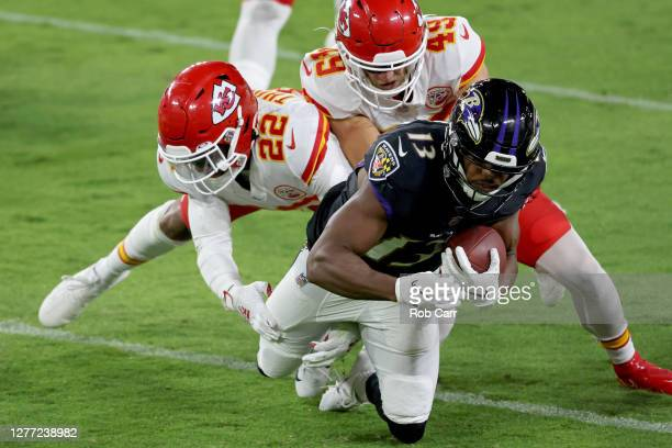 Devin Duvernay of the Baltimore Ravens is tackled by Juan Thornhill and Daniel Sorensen of the Kansas City Chiefsduring the first quarter at M&T Bank...