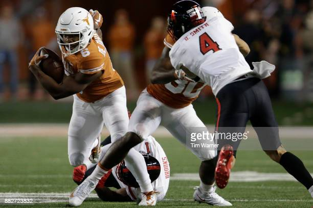 Devin Duvernay of the Texas Longhorns escapes a tackle by Jordyn Brooks of the Texas Tech Red Raiders in the second half at Darrell K RoyalTexas...