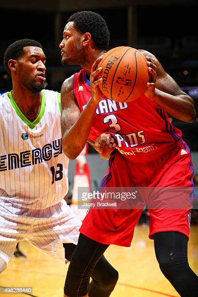 Devin Ebanks of the Grand Rapids Drive makes a move against Perry Jones III of the Iowa Energy in an NBA DLeague game on November 21 2015 at the...
