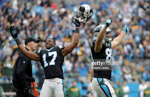 Devin Funchess and teammate Greg Olsen of the Carolina Panthers react after a touchdown against the Green Bay Packers in the third quarter during...