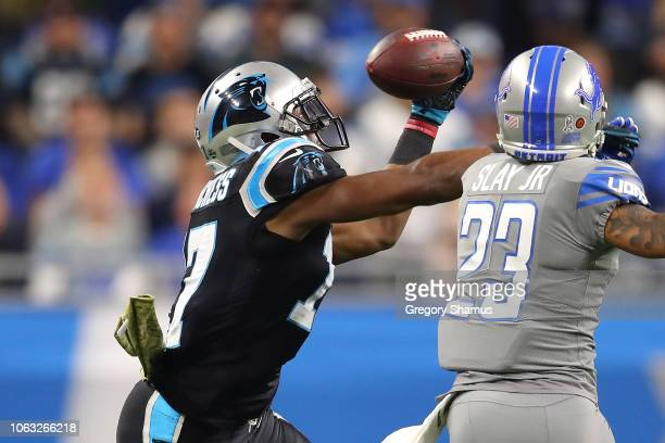 Devin Funchess of the Carolina Panthers grabs a pass in front of Darius Slay of the Detroit Lions during the first half at Ford Field on November 18,...