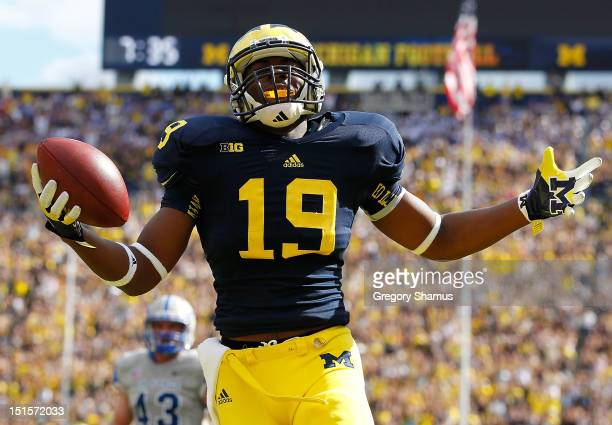 Devin Funchess of the Michigan Wolverines celebrates a second quarter touchdown against the Air Force Falcons at Michigan Stadium on September 8 2012...