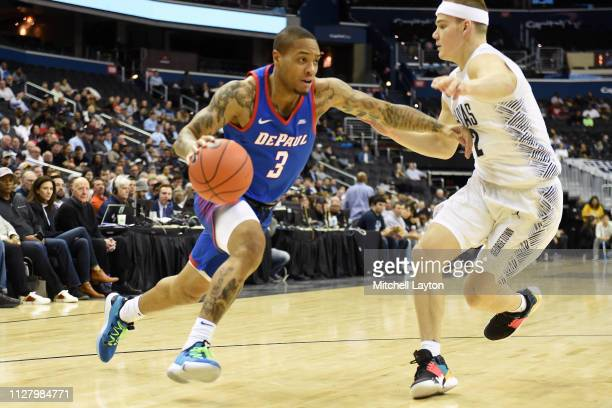 Devin Gage of the DePaul Blue Demons dribbles by Mac McClung of the Georgetown Hoyas in the second half during a college basketball game at the...