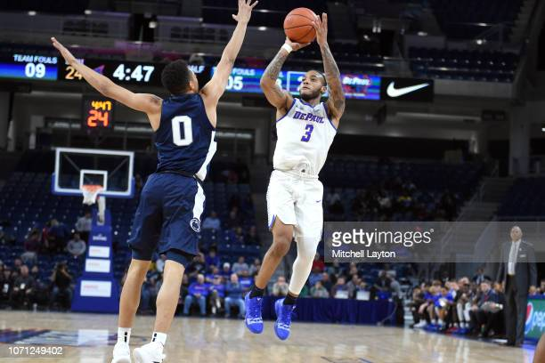 Devin Gage of the DePaul Blue Demons takes a jump shot Myreon Jones of the Penn State Nittany Lions during a college basketball game at the WIntrust...