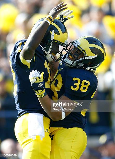 Devin Gardner of the Michigan Wolverines celebrates a first quarter touchdown with Thomas Rawls while playing the Iowa Hawkeyes at Michigan Stadium...