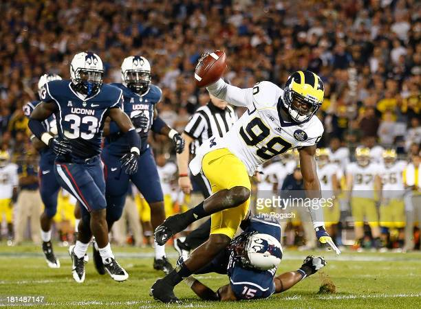 Devin Gardner of the Michigan Wolverines runs the ball in for a touchdown during a game with the Connecticut Huskies at Rentschler Field on September...