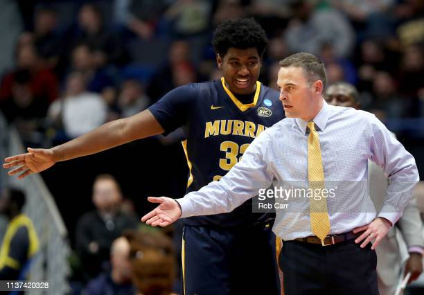 Devin Gilmore of the Murray State Racers speaks to head coach Matt McMahon during the first round game of the 2019 NCAA Men's Basketball Tournament...