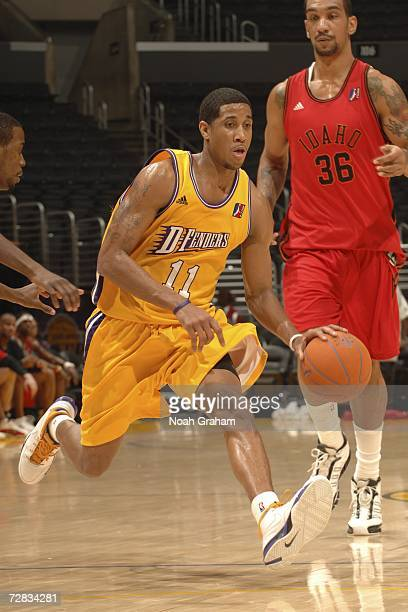 Devin Green of the Los Angeles DFenders drives to the hoop against Peter John Ramos of the Idaho Stampede on December 15 2006 at Staples Center in...