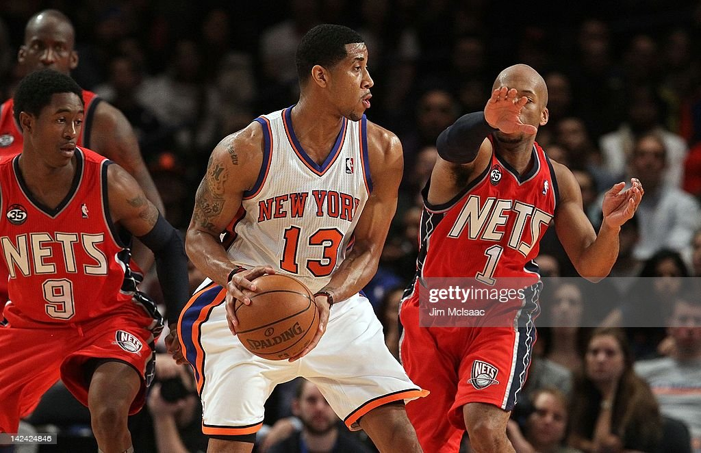 official photos 074ee f19e7 Devin Green of the New York Knicks in action against the New ...