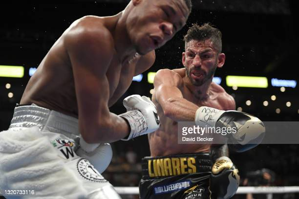 Devin Haney and Jorge Linares battle during their WBC lightweight title fight at Michelob ULTRA Arena on May 29, 2021 in Las Vegas, Nevada.