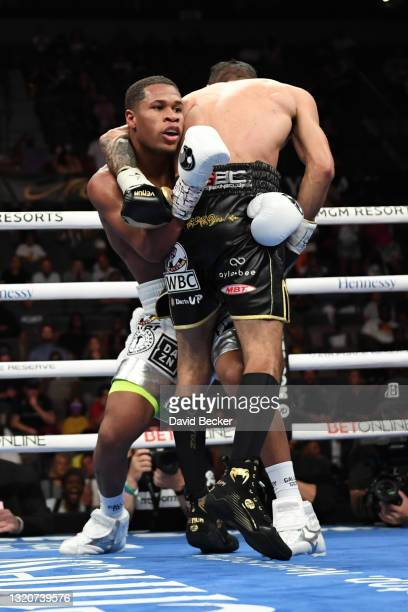 Devin Haney and Jorge Linares battle during their WBC lightweight title fight at Michelob ULTRA Arena on May 29, 2021 in Las Vegas, Nevada. Haney won...
