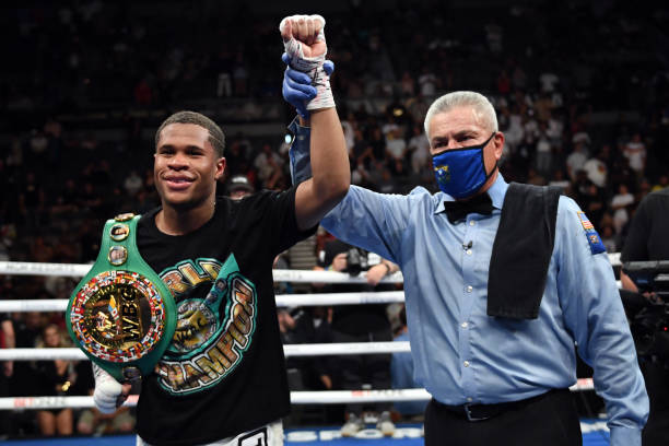 Devin Haney poses with referee Russell Mora after retaining his title of the WBC lightweight champion against Jorge Linares at Michelob ULTRA Arena...