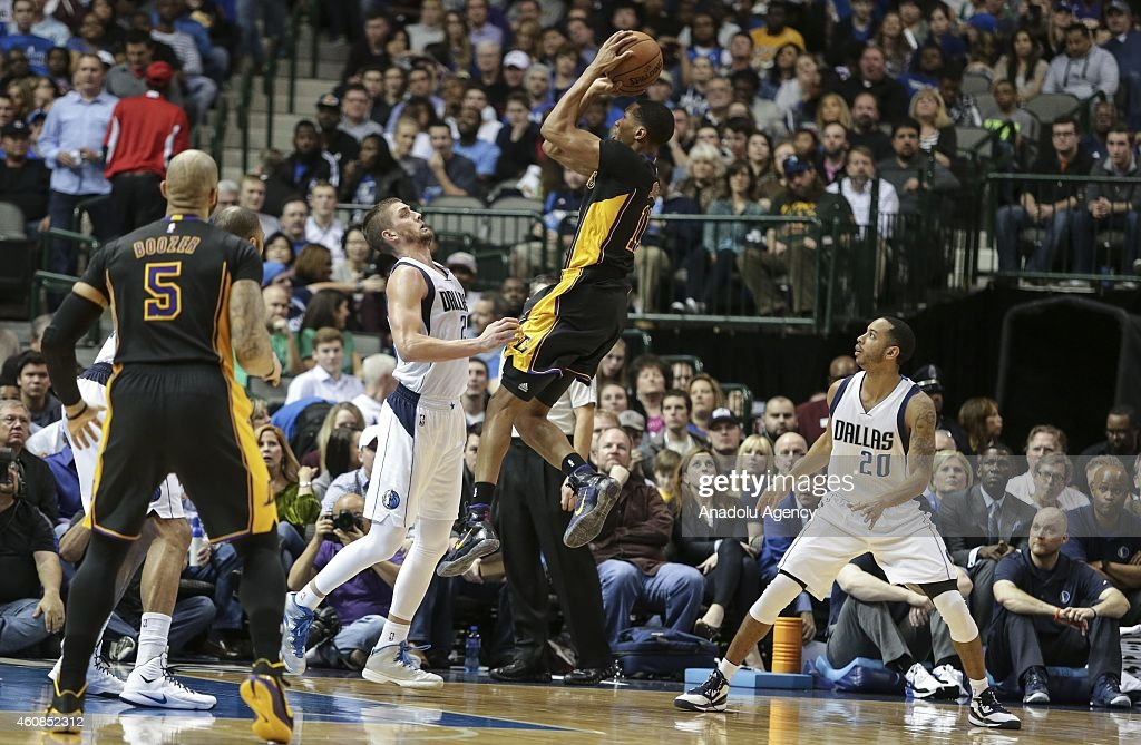 Devin Harris #20, Chandler Parsons (3rd R) of the Dallas Mavericks vie for ball against Carlos Boozer #5 and Wesley Johnson (2nd R) of Los Angeles Lakers during a basketball match on December 26, 2014 at the American Airlines Center in Dallas, Texas.