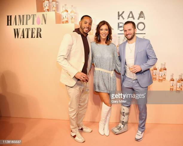 Devin Harris Charlotte Jones Anderson and JJ Barea attend the KAABOO Texas Welcomes Hampton Water at The Joule Hotel on February 28 2019 in Dallas...