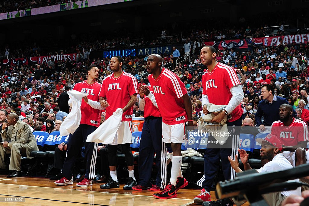 Devin Harris #34 of the Atlanta Hawks and the Atlanta Hawks bench reacts to a play against the Indiana Pacers during Game Four of the Eastern Conference Quarterfinals in the 2013 NBA Playoffs on April 29, 2013 at Philips Arena in Atlanta, Georgia.