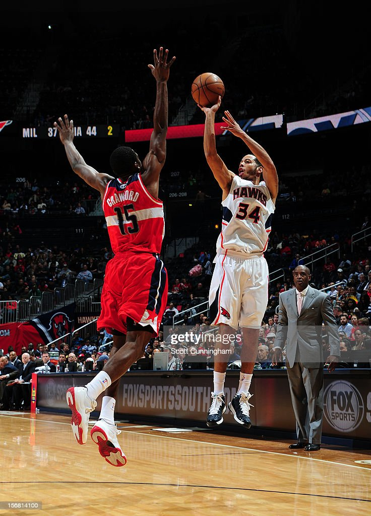 Devin Harris #34 of the Atlanta Hawks takes a deep jumpshot vs the Washington Wizards at Philips Arena on November 21, 2012 in Atlanta, Georgia.